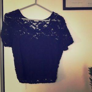 Black lace flower pattern top - Garage. Size: M